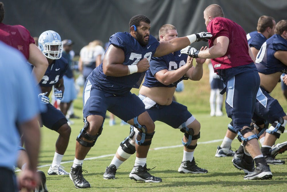 UNC offensive lineman Landon Turner takes the road less traveled