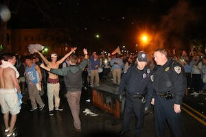 Law enforcement officers put out bonfires onFranklin Street after North Carolina's 76-72 victory over Dukeon Saturday.
