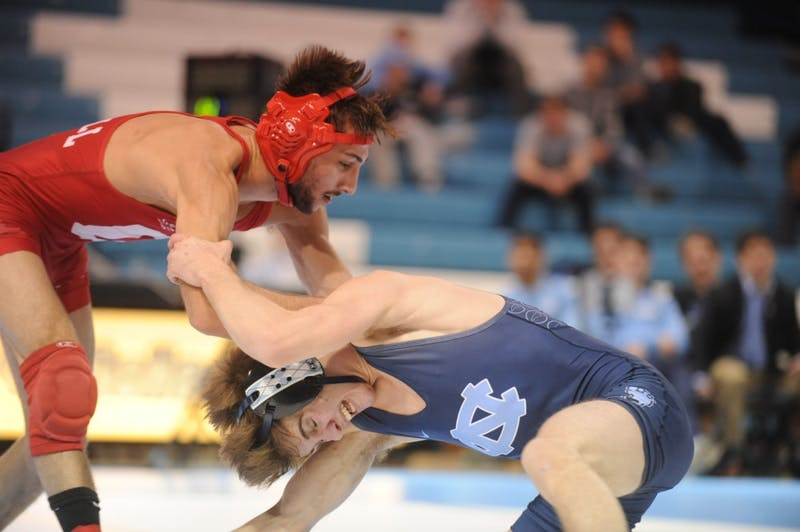 UNC redshirt junior A.C. Headlee faces a 2-8 loss from first-ranked Cornell sophomore Yianni Diakomihalis. No. 9 Cornell defeated UNC 29-5 on Saturday, Feb. 17, 2019 in the Carmichael Arena.