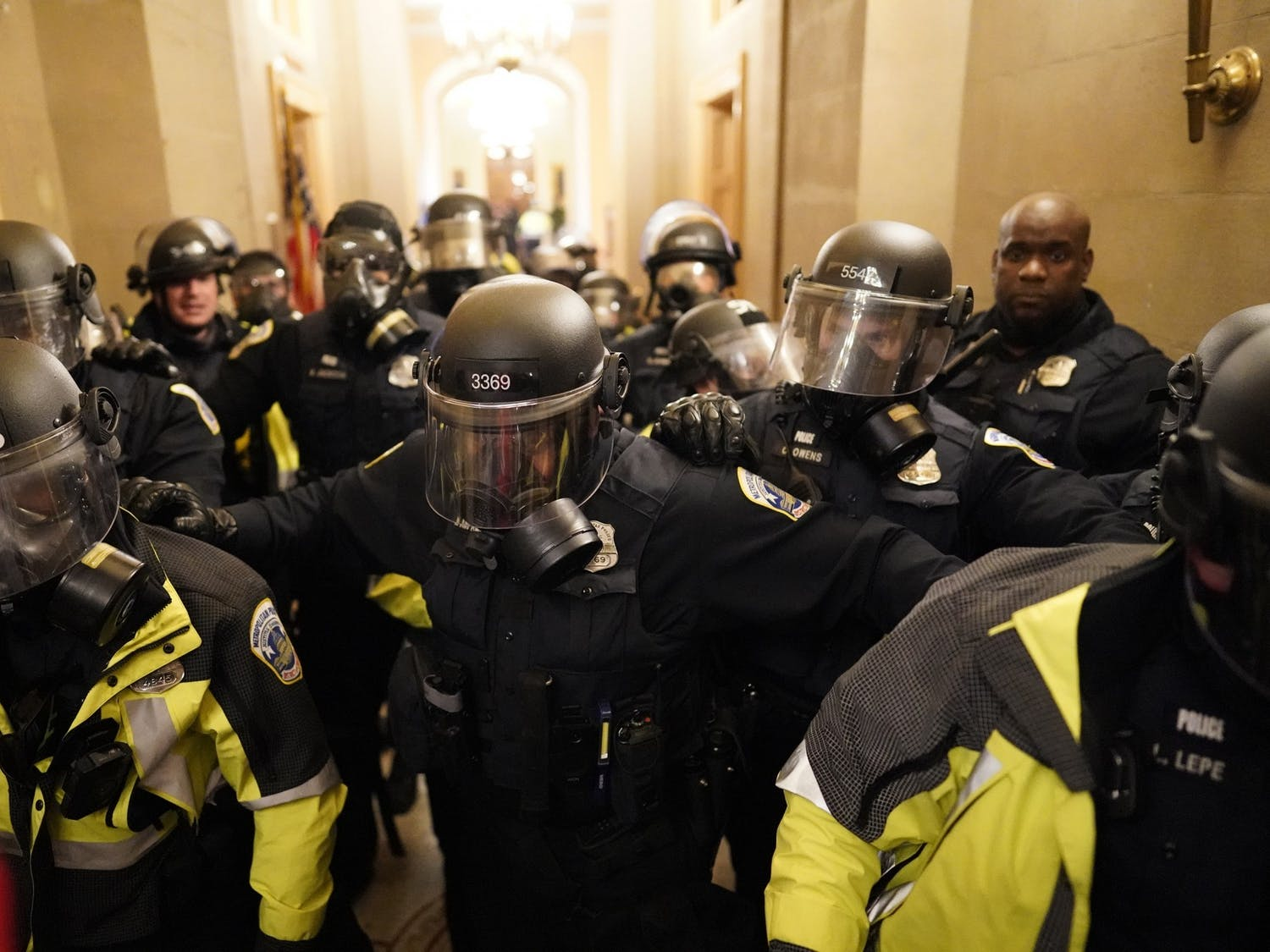 Riot police clear the hallway inside the U.S. Capitol on Jan. 6, 2021, in Washington, D.C. Photo courtesy of Kent Nishimura/Los Angeles Times/TNS