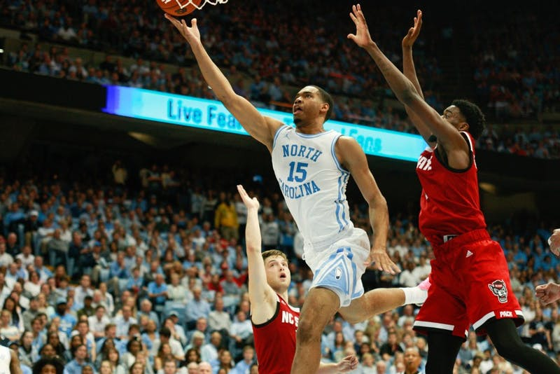 Sophomore forward Garrison Brooks (15) takes a shot during UNC's 113-96 win at the Smith Center on Tuesday, Feb. 5, 2019.