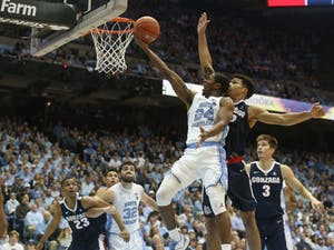 UNC guard Kenny Williams (24) goes up for a shot during the game against Gonzaga at the Dean Dome on Saturday night. UNC won 103 - 90.
