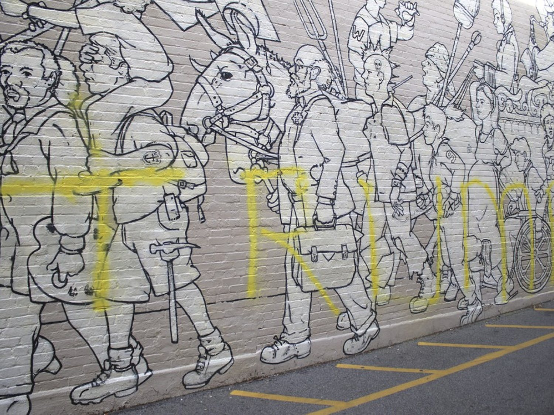 Trump graffiticovers the mural near Carolina Coffee Shop.