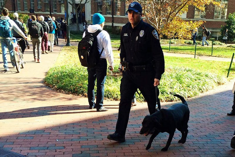A K9 unit walks near Carroll Hall on Thursday afternoon following a threatening Yik Yak post late Wednesday night.