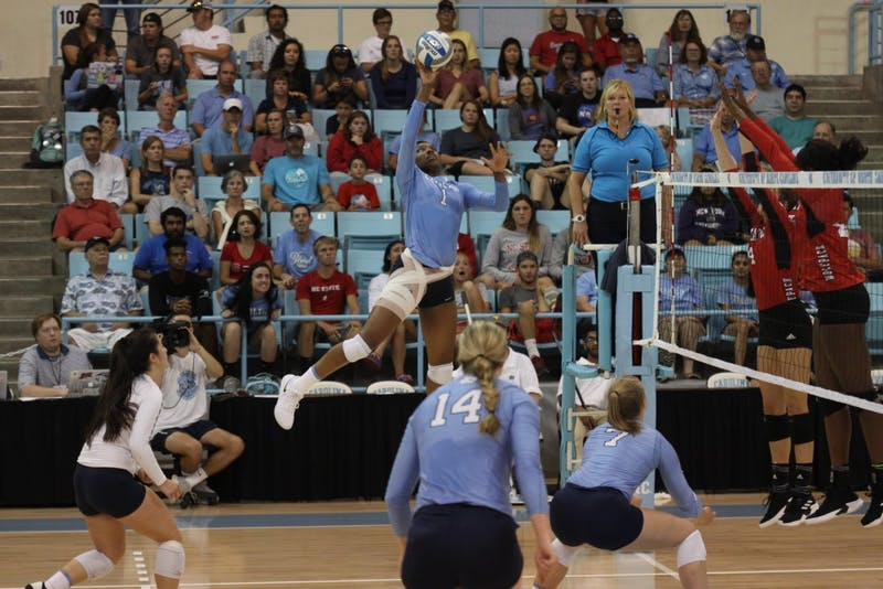 Destiny Cox, freshman and outside hitter for UNC's women's volleyball team, strikes the ball in a game against N.C. State on Wednesday, Sept. 29, 2018.