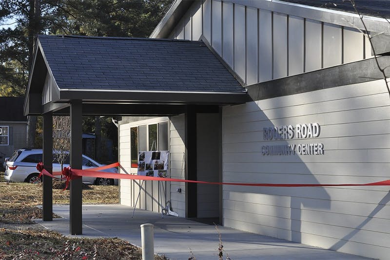 Residents of the Rogers Road community gathered on Saturday morning to celebrate the opening of a new facility that will serve as a place to gather and to nurture, educate and protect the children.