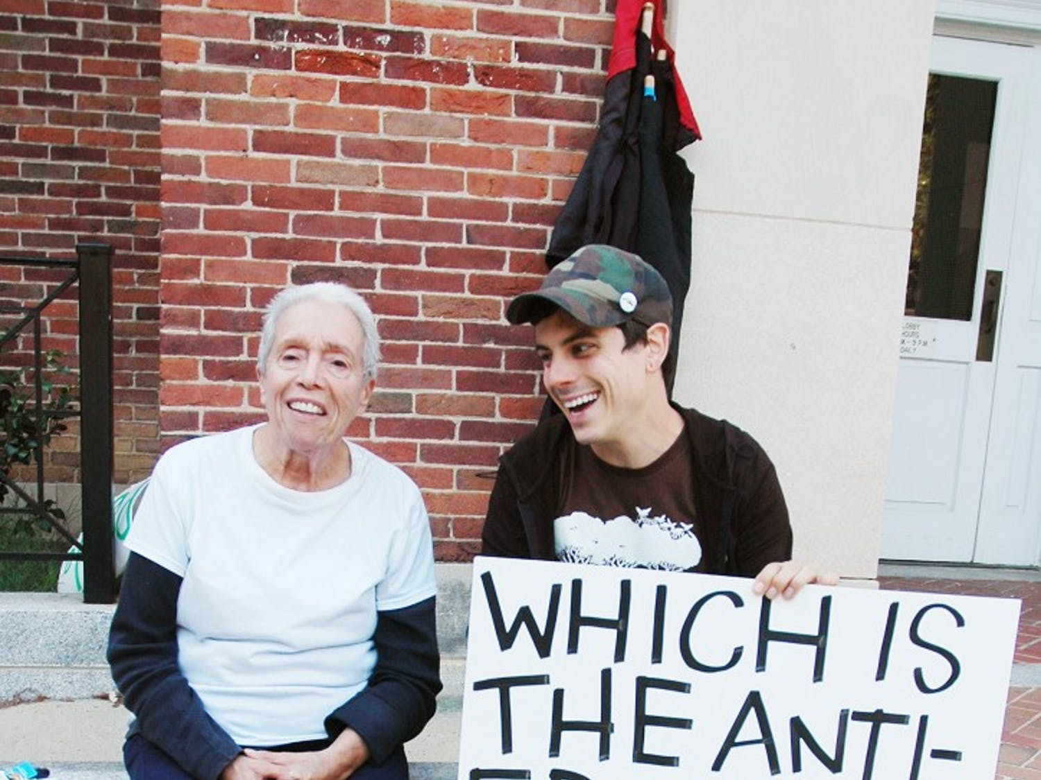 The Occupy Chapel Hill movement celebrates its 1st anniversary. Members handed out pamphlets and held banners to demonstrate their anti-government beliefs.Miriam Thompson, post graduate, and Mike Cohen, 28, discuss relevant issues to the Occupy Movement.