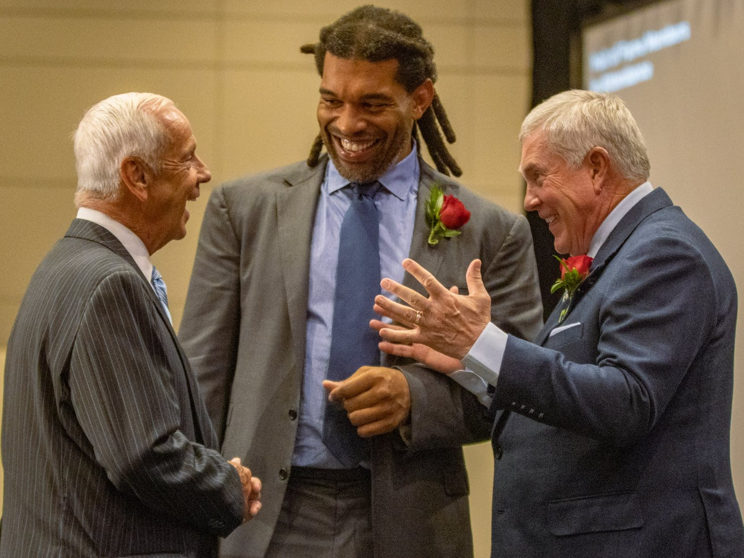 Roy Williams shares a laugh with inductees Mack Brown and Julius Peppers during the North Carolina Sports Hall of Fame induction ceremony Friday.