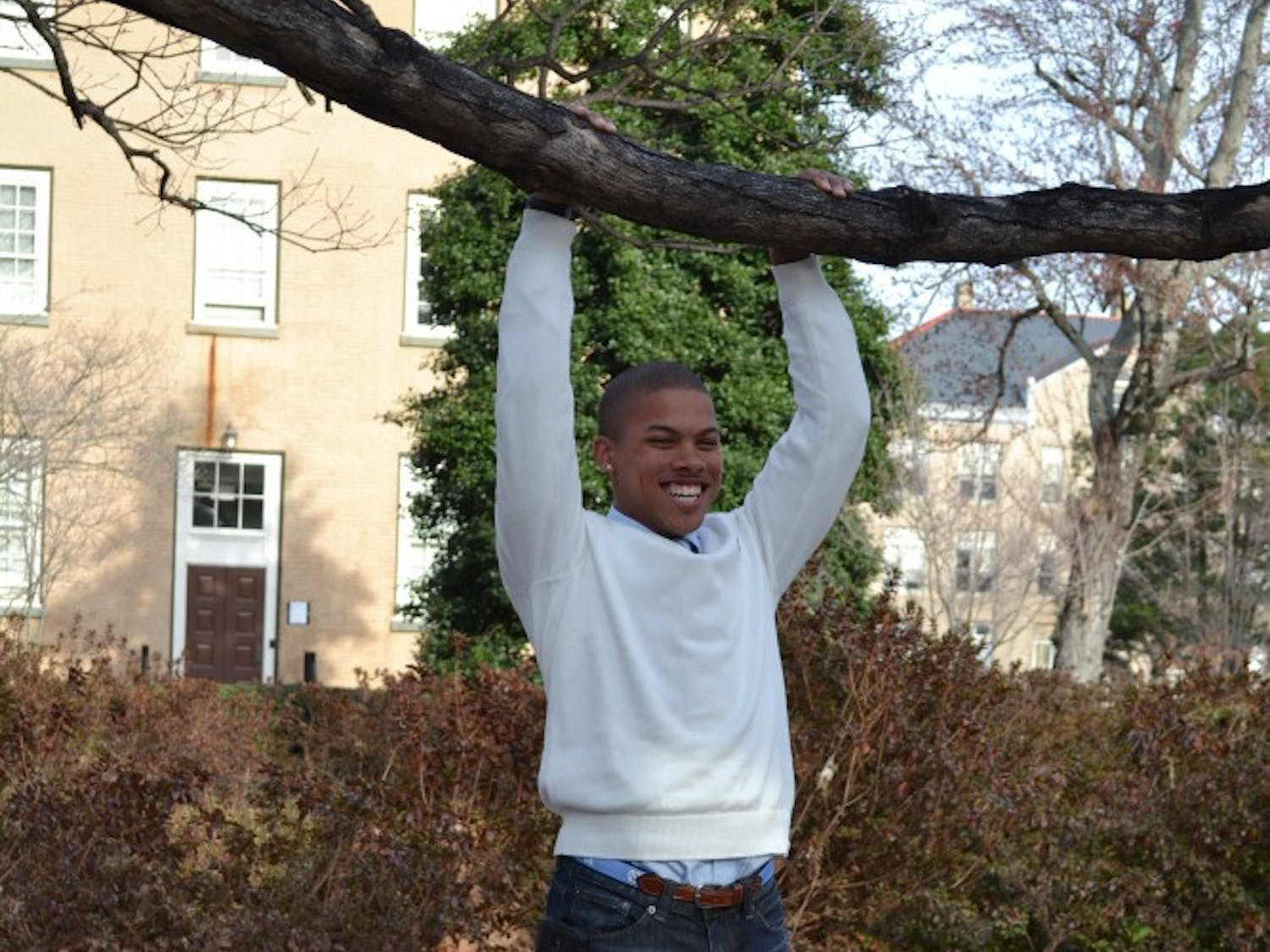 """Calvin Lewis Jr. """"hangs out"""" near the Old Well."""