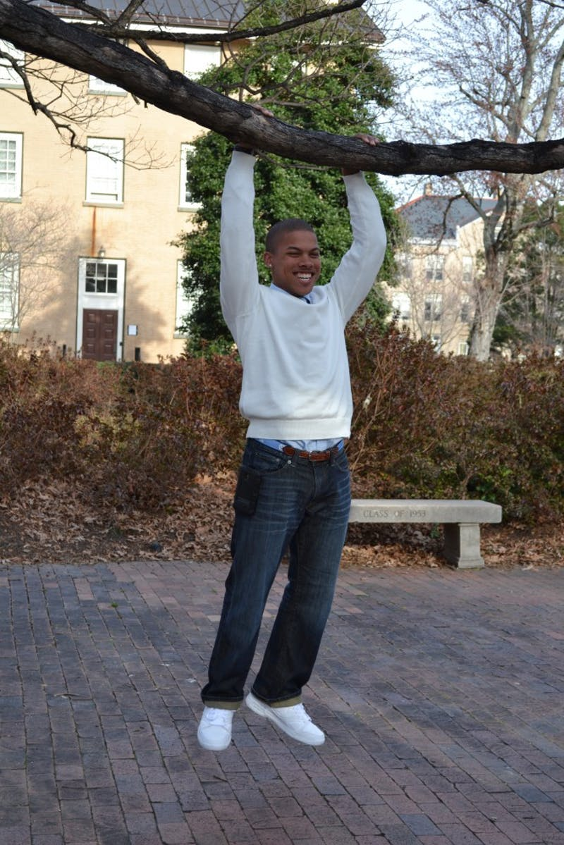 "Calvin Lewis Jr. ""hangs out"" near the Old Well."