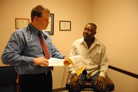 Dr. Brian Forrest informs his patient Franklin Torere of his results after a physical. DTH/Helen Woolard