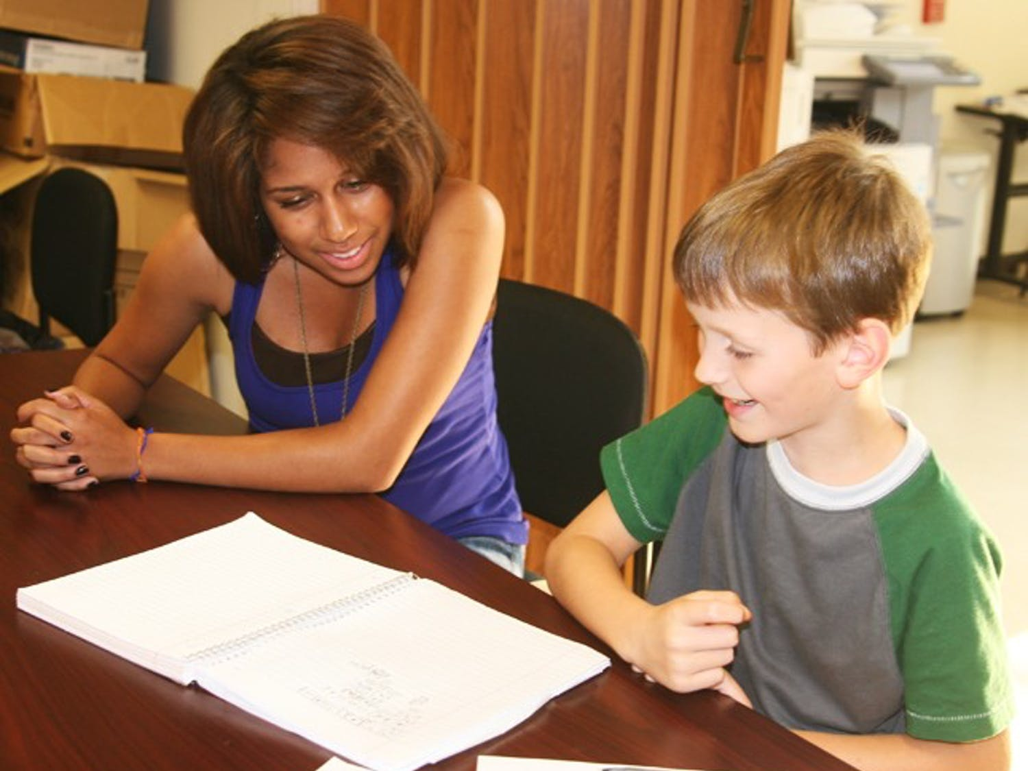 Jasmine Nesi, a tutor with UNC Habitat for Humanity, helps Zachary Butcher, 9, with his math homework at Central Elementary in Hillsborough.