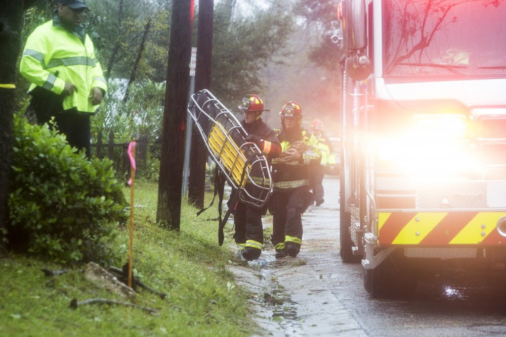 <p>A member of the Wilmington Fire Department brings in a stretcher to assist with the removal of a mother and an infant who died when a tree fell, due to Hurricane Florence, on their bedroom on Friday, Sept. 13th in Wilmington, N.C. After hours spent rescuing the father from the residence on Mercer Ave in Wilmington, N.C. unconfirmed reports of the tragic death of a mother and infant began to spread. Local officials confirmed these reports at a press briefing at the disaster command center located in the government center in Wilmington, N.C.&nbsp;</p>