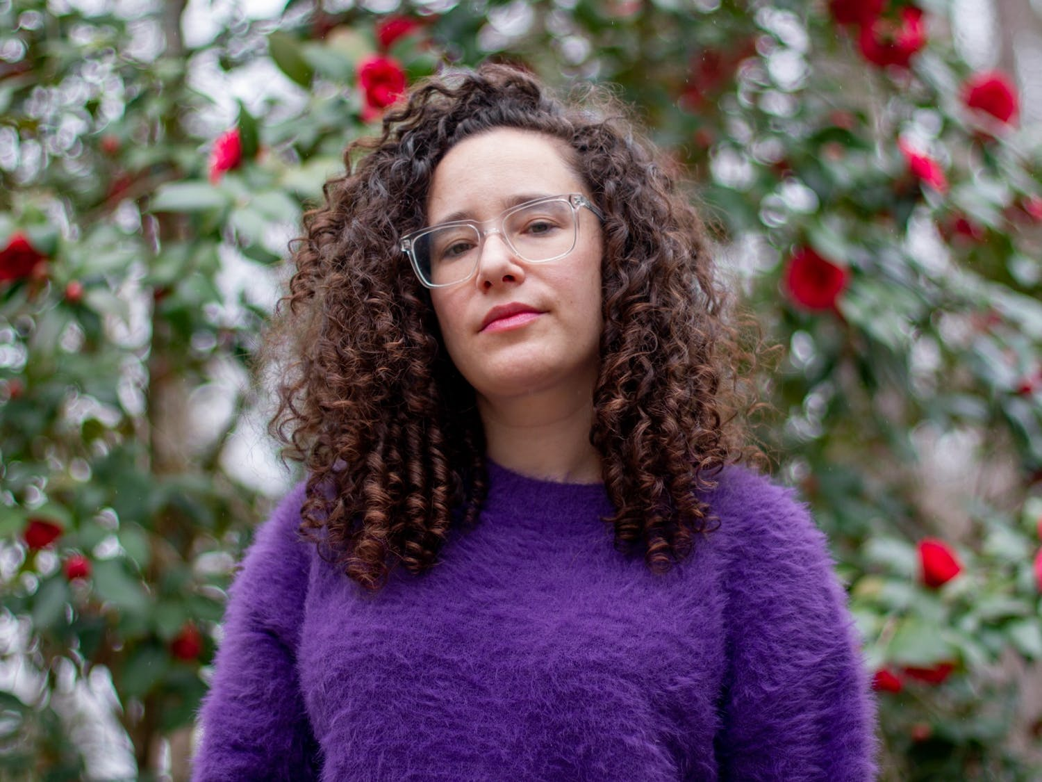 """Rachel Kiel, a songwriter and musician based in Carrboro, poses for a portrait at her home in Carrboro on Tuesday, Mar. 23, 2021. """"I've loved every type of music since I was young,"""" says Kiel. """"To live here [and] write songs forever... I'm down for that."""""""
