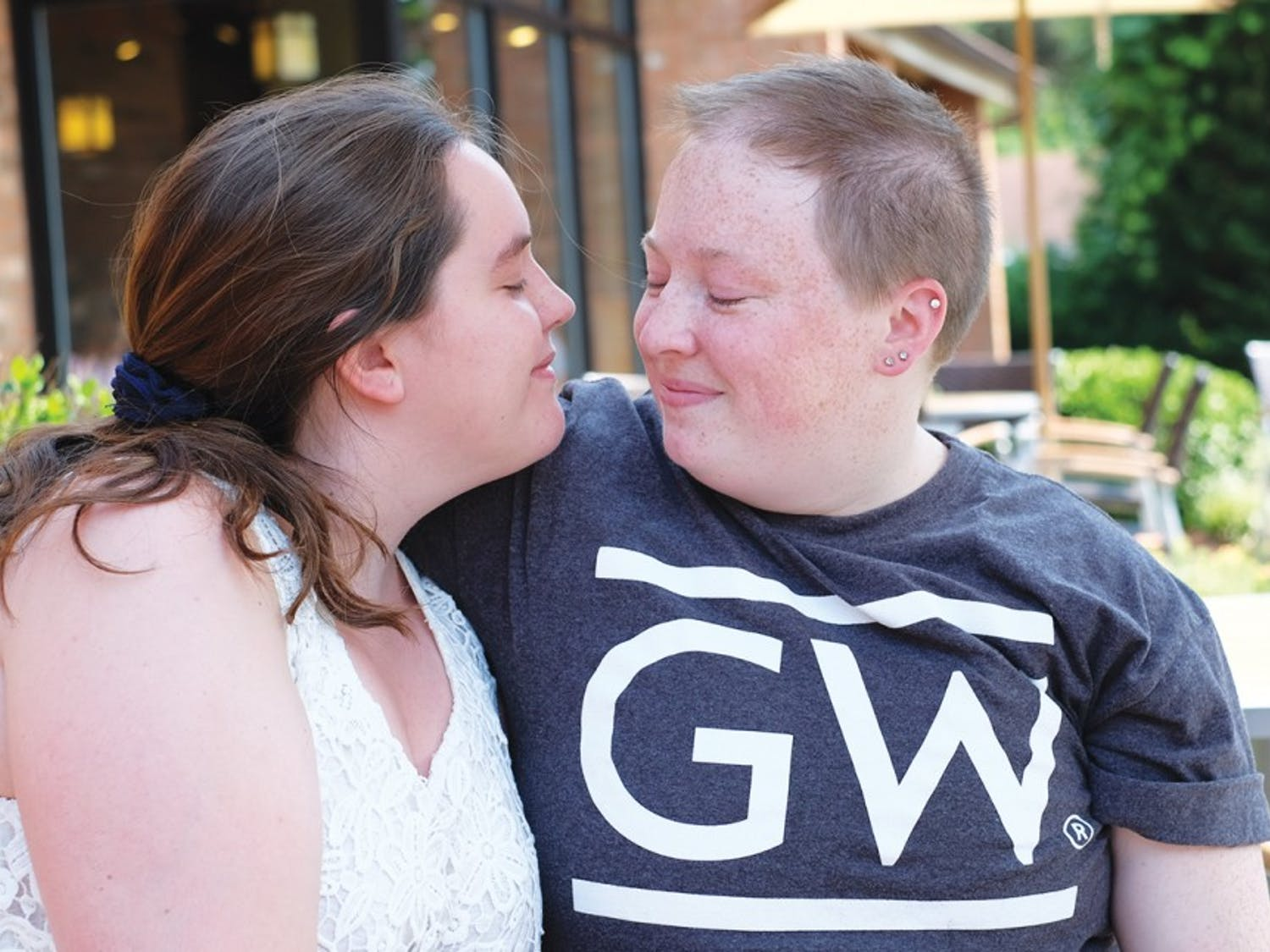 Danielle Martin (left) and Katy Folk pose in front of Caribou Coffee on June 30. Martin and Folk plan to get married in North Carolina in May 2016.
