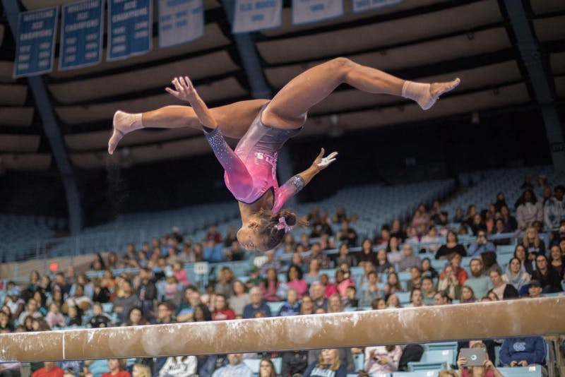 Khazia Hislop competes on the beam during home opener and annual Women's Day and Pink Meet against Oklahoma and Ball State on Saturday, Jan. 19, 2019. UNC placed second behind Oklahoma.