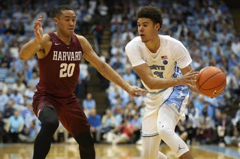 Harvard guard Justin Bassey (20) guards UNC guard Cameron Johnson (13) in the Smith Center Wednesday, Jan. 2, 2019. UNC defeated Harvard 77-57.