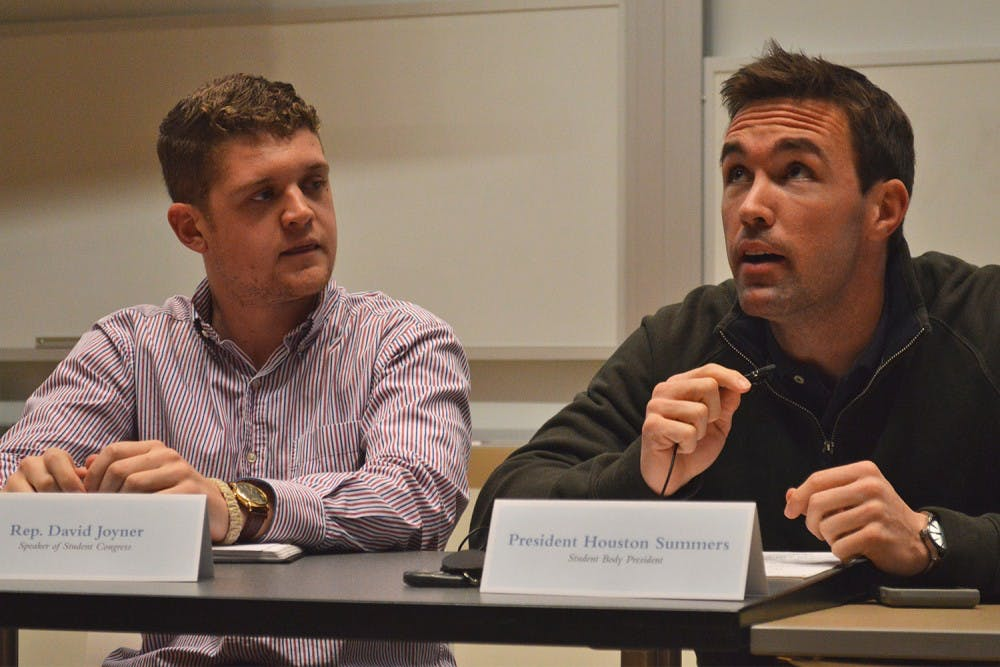 David Joyner, speaker of the student congress, and Houston Summers, student body president, discussed how they could better serve both undergraduate and graduate student needs at a town hall meeting in the Genome Science Building Monday night.
