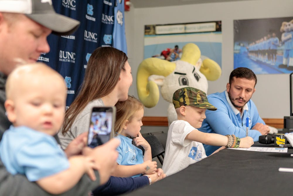 <p>UNC's wrestling team has developed a close relationship with eight-year-old Mason Fannin, who has been battling Leukemia since February 2019. Photo Courtesy of UNC Athletics.&nbsp;</p>