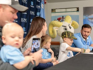 UNC's wrestling team has developed a close relationship with eight-year-old Mason Fannin, who has been battling Leukemia since February 2019. Photo Courtesy of UNC Athletics.