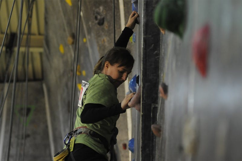 This weekend the Chapel Hill Community Center held the 25th Anniversary Dixie Rock Climbing Competition.  Kat Richards, a regular at the community center and a Chapel Hill native, is seen climbing one of the 17 wall routes.  Individuals received points for each route they completed.