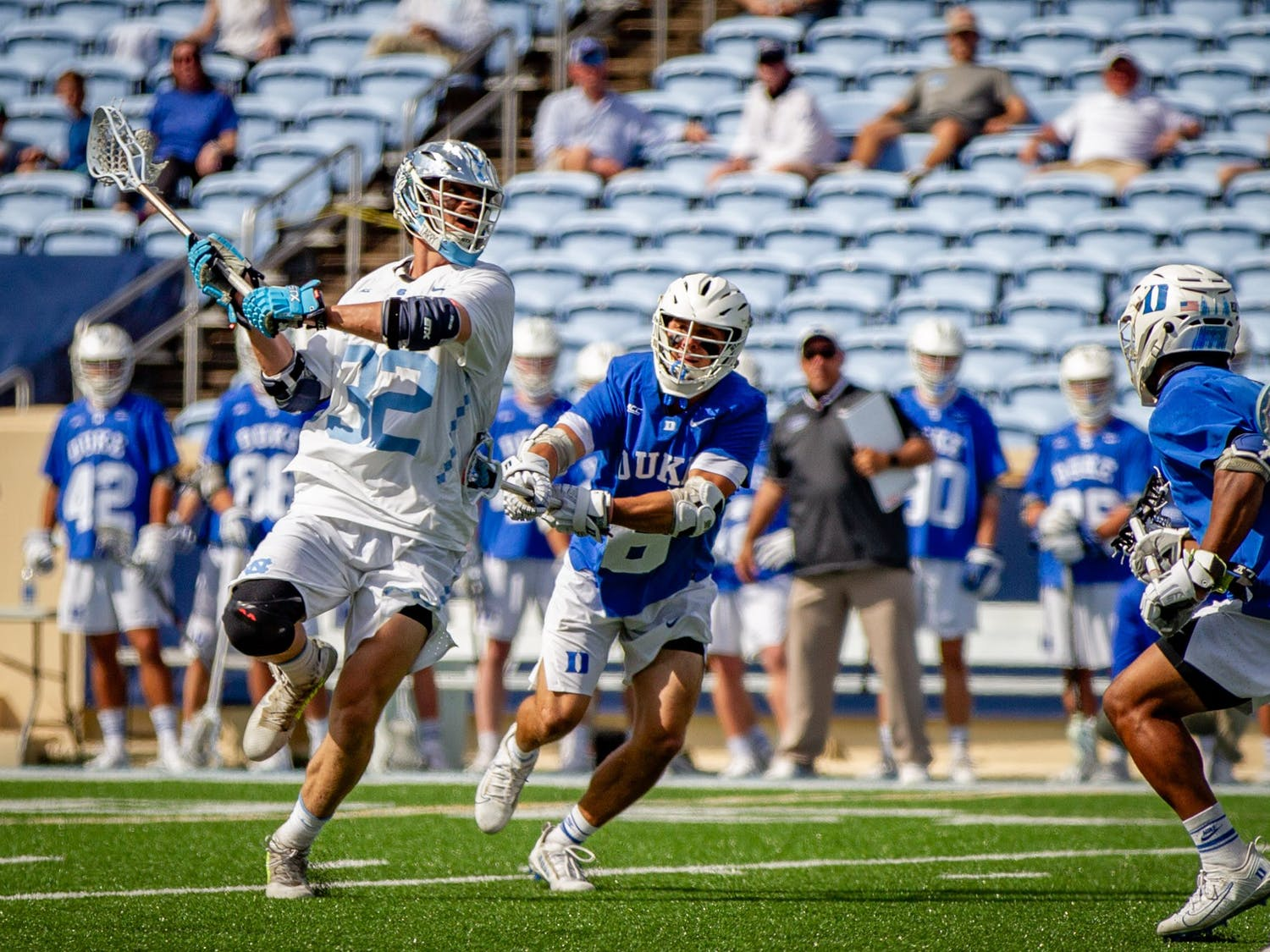 UNC graduate midfielder Connor McCarthy (32) takes a shot on the goal during the Tar Heels' 15-12 victory against Duke on Sunday, May 2. With the victory, UNC and Duke share the 2021 ACC regular season title.