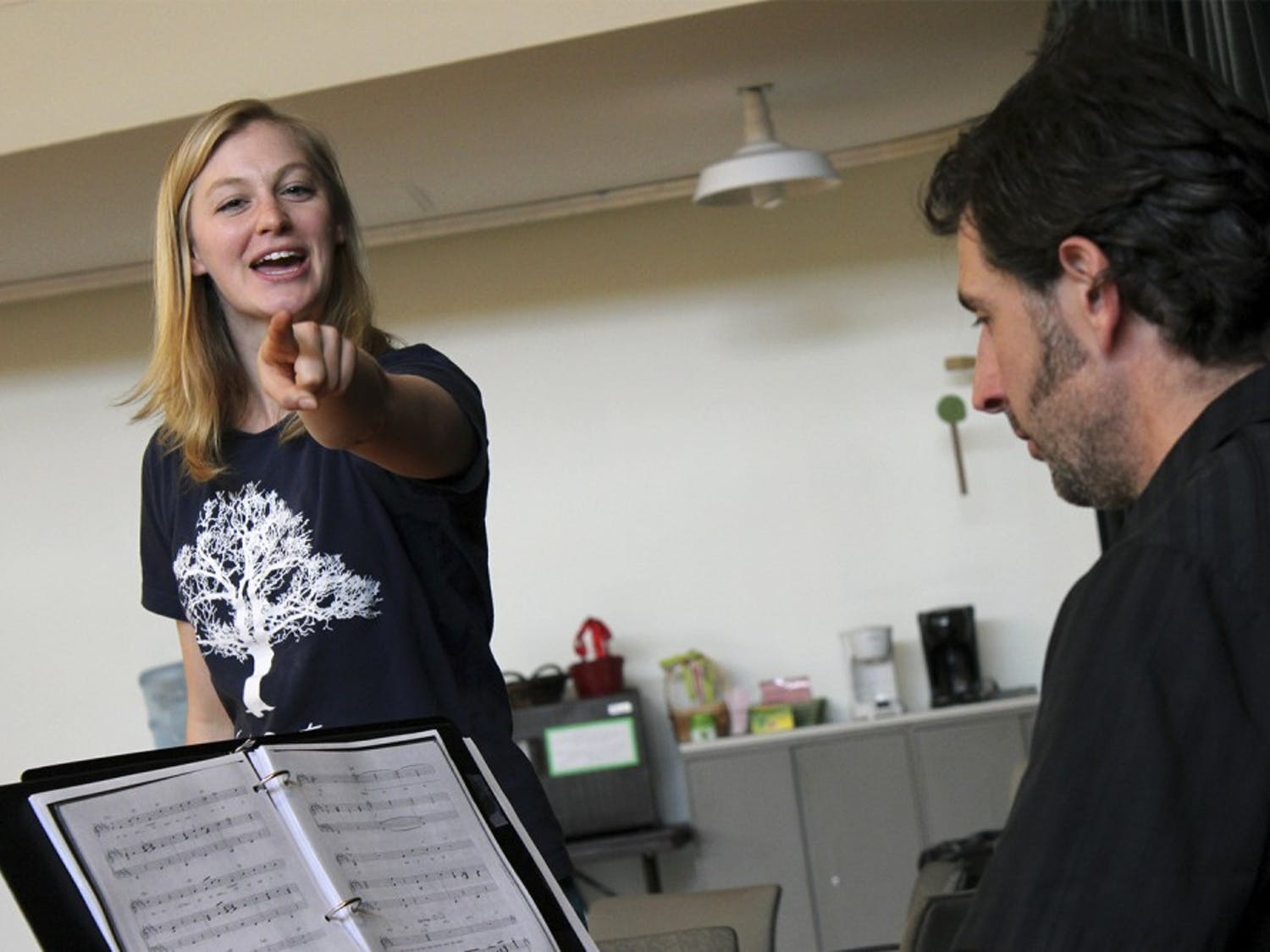 Director and UNC MFA student Arielle Yoder rehearses a Broadway number with music director Jesse Kapsha on keys.Photo courtesy of Wagon Wheel Arts.
