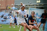 Team captain and third-year attacker Katie Hoeg (8) plays during ACC kick-off game against UVA. UNC won 13-12 at Fetzer Field in Chapel Hill on March 9, 2019.