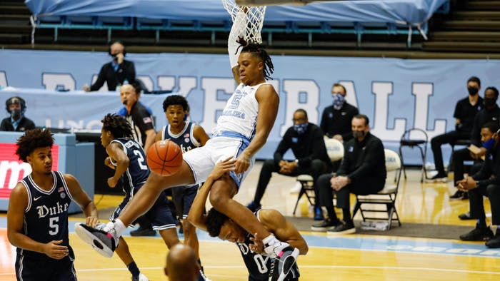 UNC sophomore center Armando Bacot (5) dunks the ball during a game against Duke in the Smith Center on Saturday, March 6, 2021.