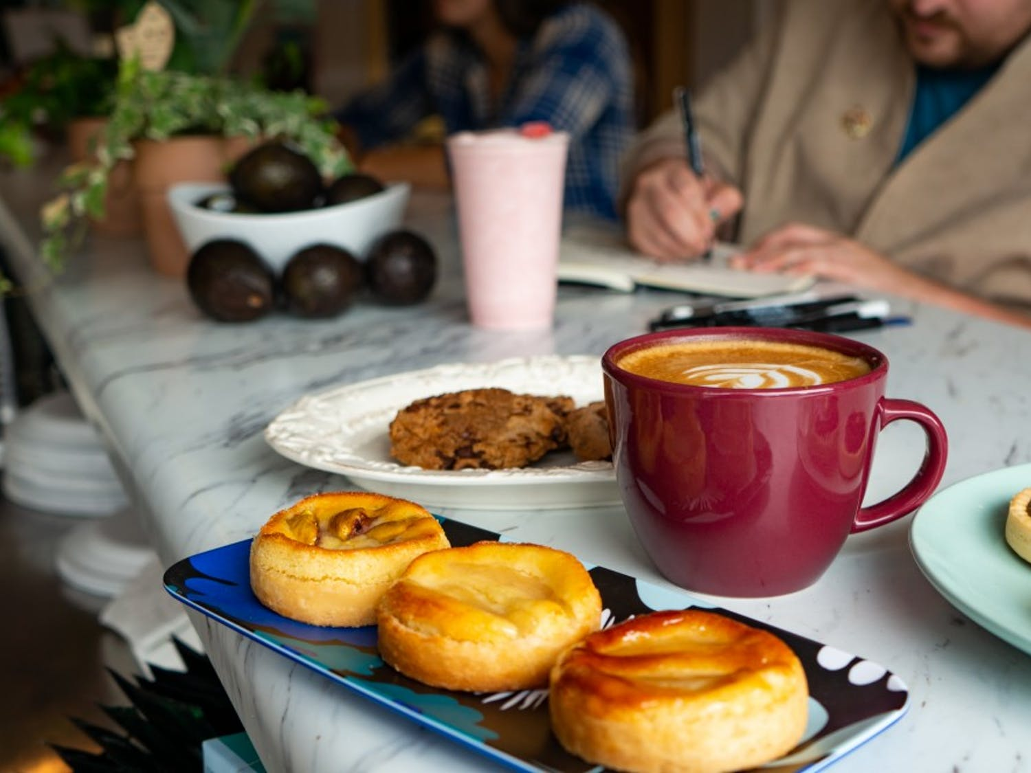 Homemade pastries and coffee sit on the counter of Three Waters Café on Wednesday, Oct. 9, 2019. Three Waters Café just opened recently on Franklin Street.