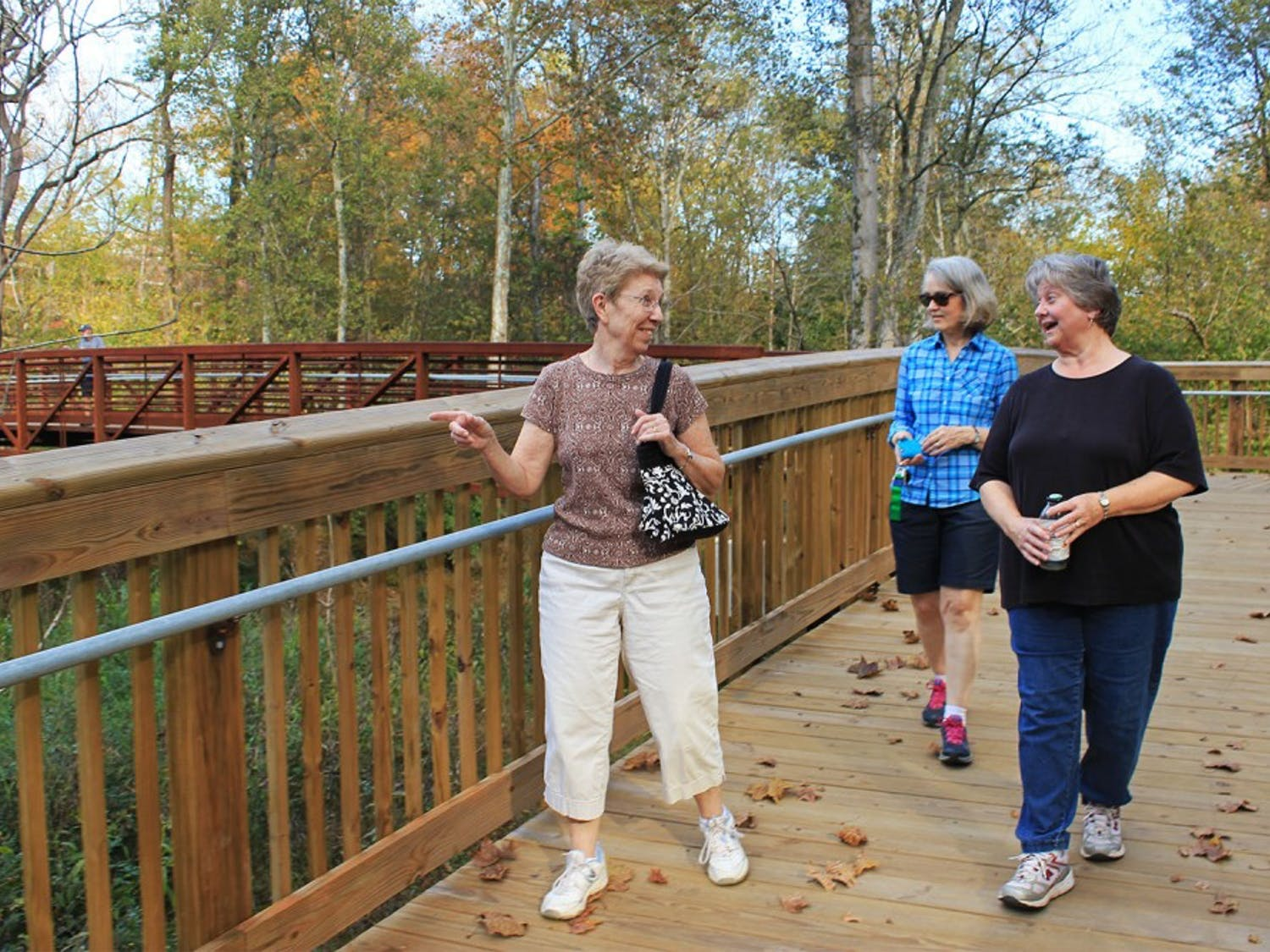 "Locals Jan Irwin, Dail White, and Ivy Bishop went walking in Hillsborough Tuesday afternoon, exploring the town's recently constructed Riverwalk. Irwin commented on the new installation, ""I just could not believe how well constructed it was...it just blew me away."""