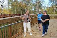 """Locals Jan Irwin, Dail White, and Ivy Bishop went walking in Hillsborough Tuesday afternoon, exploring the town's recently constructed Riverwalk. Irwin commented on the new installation, """"I just could not believe how well constructed it was...it just blew me away."""""""