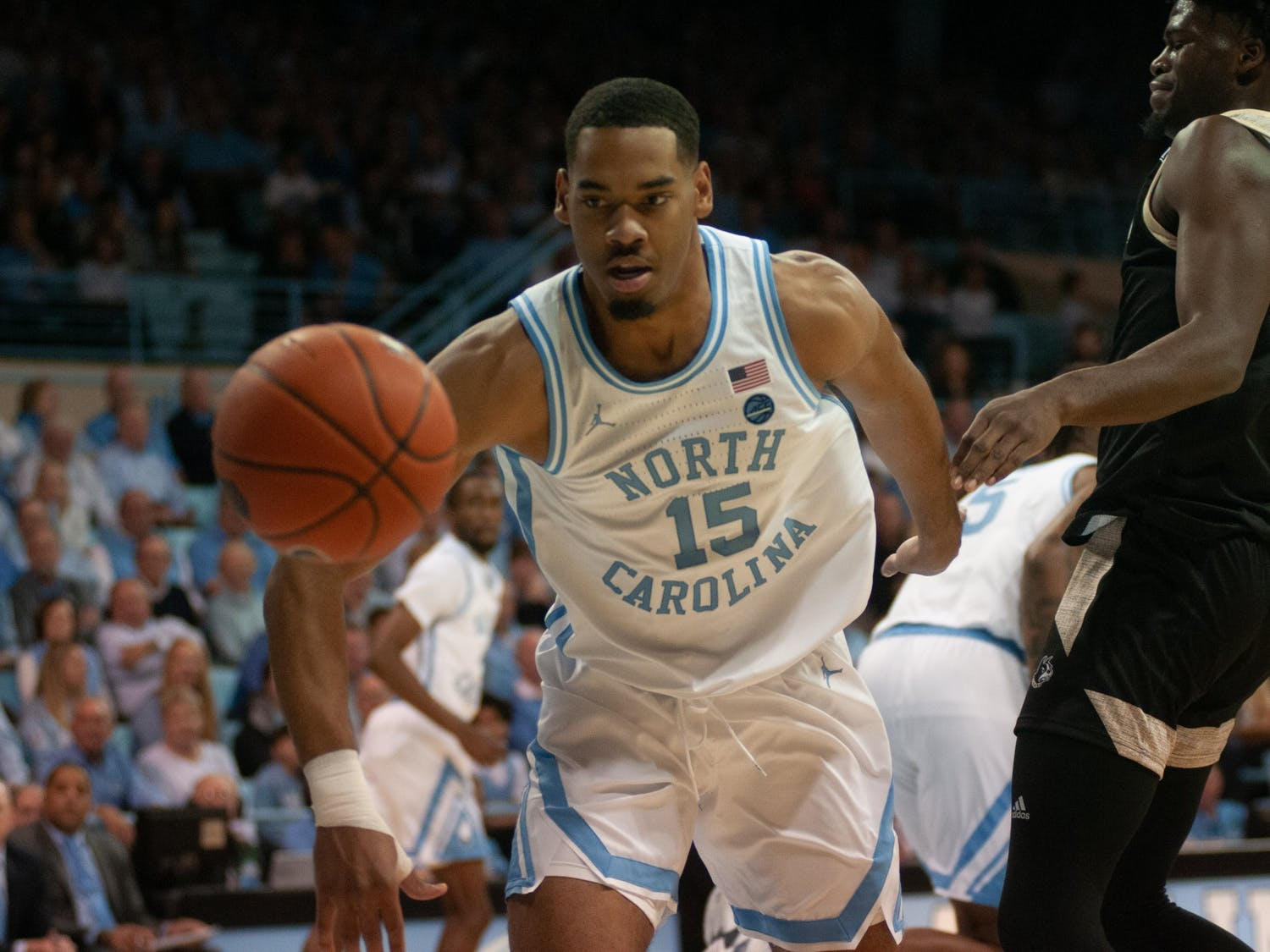 UNC junior forward Garrison Brooks (15) dribbles down court in Carmichael Arena on Sunday, Dec. 15, 2019 against Wofford. This is the first regular-season game the Tar Heels have played in Carmichael since 1986.