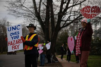 Memembers of the community protest in front of the coal power plant on Cameron Avenue on Friday, Feb. 14, 2020. The protestors have gather here every Friday morning since May 2019 to complain that the plant is still operating. In 2010, former Chancellor Holden Thorpe said that UNC would stop using the plant by 2020.