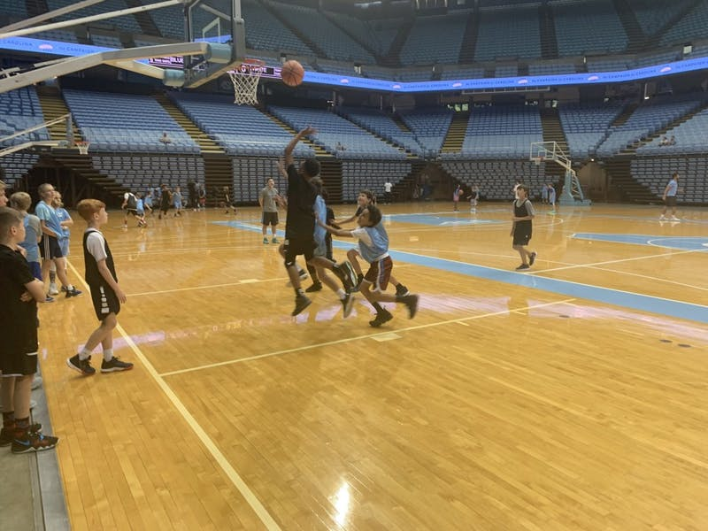 Campers at Antawn Jamison playing in a scrimmage in the Dean Smith Center.