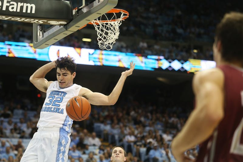 Freshman forward Luke Maye (32) comes down after making a shot. Maye scored six points.