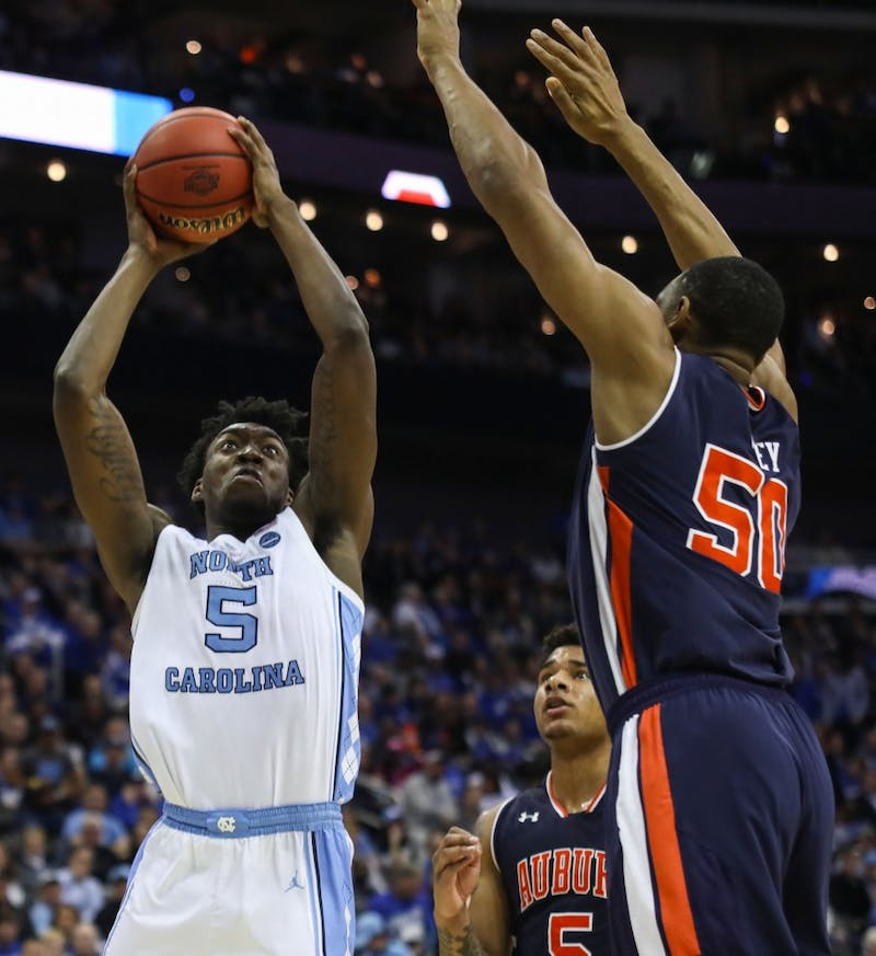 Auburn junior center Austin Wiley (50) guards guards UNC first-year forward Nassir Little (5) during UNC's 97-80 loss against Auburn in the Sweet 16 of the NCAA Tournament on Friday, March 29, 2019 at the Sprint Center in Kansas City, M.O.