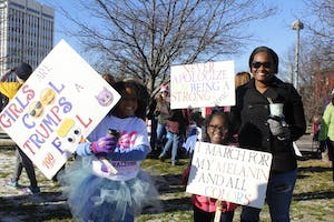 (From left) Kayla Dunson, Cheyloh Scott, and Jennifer Grayson from Fayettville, N.C. attended Saturday's march.