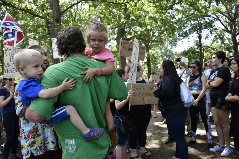 Tensions rise as Confederate supporters and protesters clash at Silent Sam