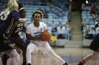 UNC redshirt senior guard Paris Kea (22) pushes down the court during Friday night's game against Kent State on Nov. 9, 2018 at Carmichael Arena. UNC won, 73-60.