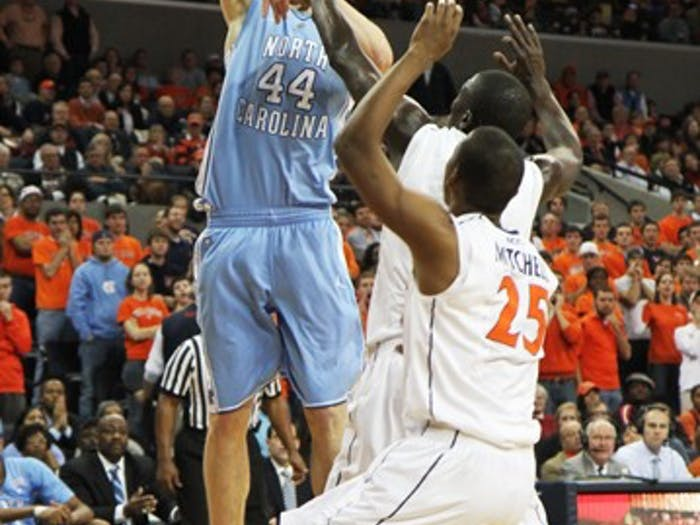 Tyler Zeller goes up for a close-range shot at UVa. His four clutch free throws tied the game late in the second half.