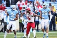 NC State wide receiver C.J. Riley (19) celebrates in front of a Carolina defenders on Saturday, Nov. 24, 2018 in Kenan Memorial Stadium.
