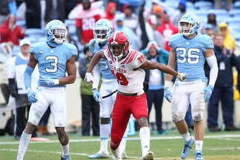 NC State wide receiver C.J. Riley (19) celebrates in front of a Carolina defenders on Saturday, Nov. 24, 2018 in Kenan Memorial Stadium.