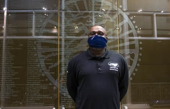 "James Holman, a crew leader for UNC housekeeping services and 15-year-long employee at the university, stands in front of a wall of honorable mentions in the Sonja Haynes Stone Center for Black Culture and History on Friday, October 16, 2020. Holman is the first recipient of the Rebecca Clark Staff Award for Moral Courage. Holman spoke about his role as a sort of liaison for his staff. ""I do a lot of advocacy work,"" Holman said. He is the person that gets complaints heard and miscommunication straightened out, before it starts to affect people's work life and mental health. ""When the staff have issues, if it's a group issue, I will take it to the forum and then we'll take it tot the Vice Chancellors and try to get the situation resolved."""