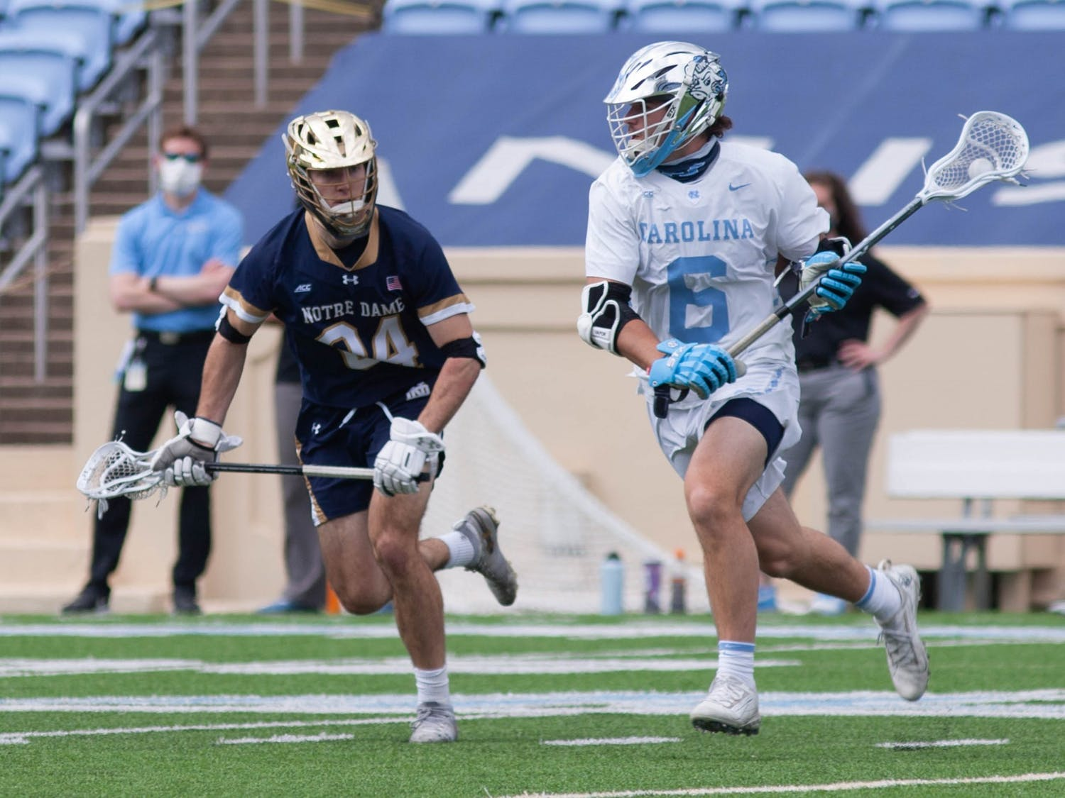UNC first-year midfielder Cole Herbert (6) cradles the ball during the game against Notre Dame on April 25, 2021 at Kenan Stadium. The Tar Heels' defeated the Fighting Irish 12-10.
