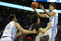 Senior guard Cameron Johnson (13) goes for a layup against Louisville in the quarterfinals of the ACC tournament on Thursday, March 14, 2019 at the Spectrum Center in Charlotte, N.C. UNC defeated Louisville 83-70 to advance to the semifinals.