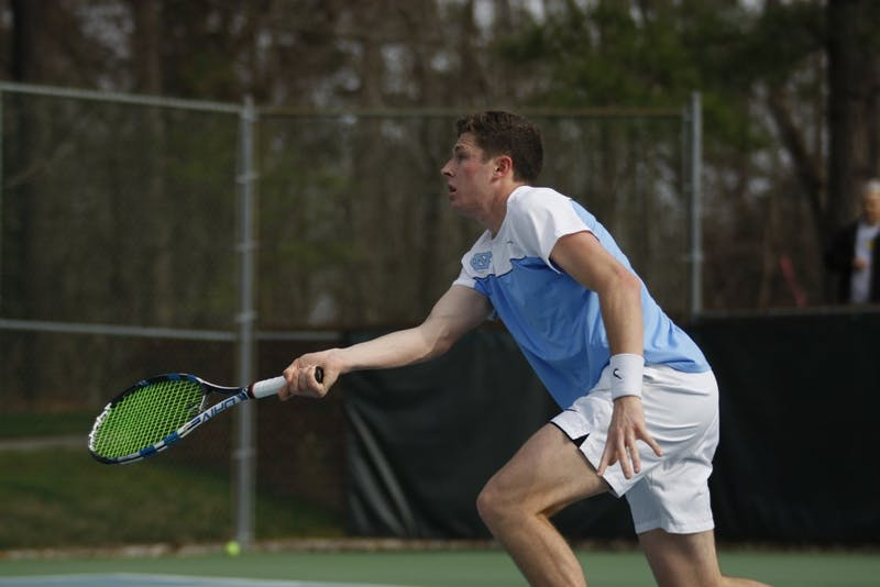 Senior Blaine Boyden, business administration major, plays for the UNC men's tennis team against Duke on Thursday, Feb. 28, 2019 at the Cone-Kenfield Center. UNC won 4-1. Boyden won his singles match.