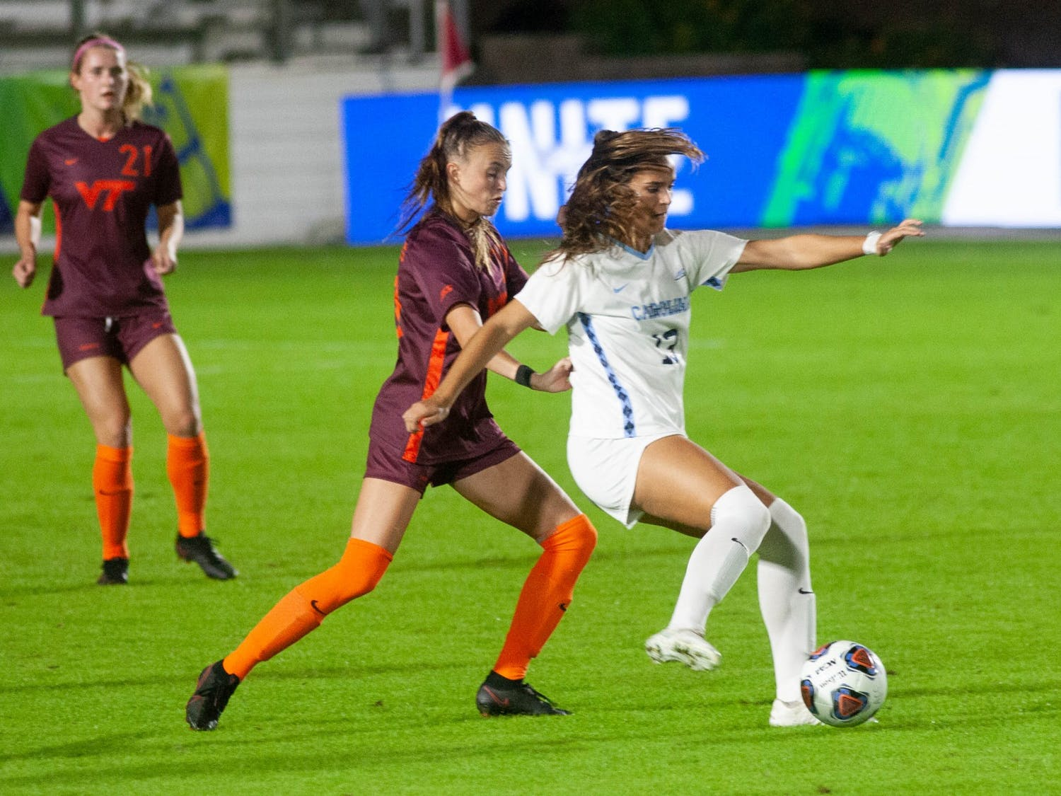 UNC sophomore forward Isabel Cox (13) kicks the ball at ACC tournament game against Virginia Tech on Tuesday, Nov. 10, 2020 at the WakeMed Soccer Park. The Tar Heels beat the Hokies 1-0.