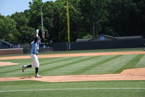 Center fielder Brian Miller celebrates during North Carolina's 8-1 win over Michigan in Chapel Hill Regional play on June 3.