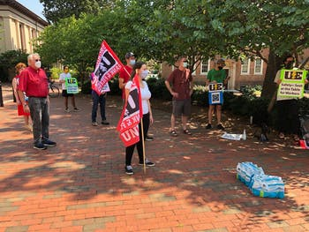 Faculty, campus workers, and graduate students rally in front of South Building for campus workers' safety and job security on Thursday, Aug. 27, 2020.
